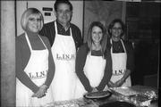From left, Stephanie Rasys, Dan Gaumer, Ranelle Fischer and Lois Uihlein, of the Lawrence Kiwanis Club, help serve desserts Nov. 22 at the Lawrence Interdenominational Nutrition Kitchen at First Christian Church. Gaumer is president of the local service organization, and Fischer is president-elect.