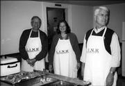 From left, Sam Seminoff, Cathy Howard and Larry Alstrom, of the Lawrence Kiwanis Club, serve entrees Nov. 22 at the Lawrence Interdenominational Nutrition Kitchen at First Chris-tian Church. The club provided the food and served the meal.