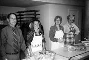 From left, Bill Winkler, Wendy Leedy, Deb Waggoner and Penny McDonald, of the Lawrence Kiwanis Club, get ready to serve salads at the Lawrence Interdenominational Nutrition Kitchen at First Christian Church. It is an annual tradition for the club to provide food and serve the meal at LINK on the Tuesday before Thanksgiving.