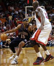 New Jersey's Vince Carter, left, works against Miami's Shaquille O'Neal. Carter scored 51 points, and the Nets beat the Heat, 95-88, Friday night in Miami.