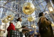 The Prudential Center in Boston is filled Friday with last-minute holiday shoppers. Retailers are hoping for big sales today as procrastinators hit the stores.