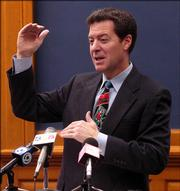 U.S. Sen. Sam Brownback, R-Kan., speaks to reporters Friday at the Kansas Statehouse in Topeka. Brownback discussed a variety of current political issues, including wiretap surveillance of U.S. citizens and his own prospects for running for president.