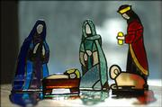Sallie Dickinson has a Nativity set of stained glass made by her father in the late 1970s and early 1980s. These are five of the 12 pieces.
