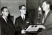 In 1961, Calder Pickett, left, met President John F. Kennedy, right, when he went to Washington, D.C., to receive a Hearst Foundation citation for Kansas University.