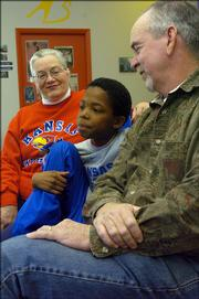 Cheryl and Charlie Thomas talk with Carnell, 10, about the trio's experience with Big Brothers and Big Sisters.