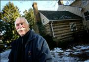 "Greg Mallet-Prevost stands Wednesday in front of the cabin in Rockville, Md., where Josiah Henson lived,  the man whom Harriet Beecher Stowe used as a model for the Uncle Tom character in her 1852 novel, ""Uncle Tom&squot;s Cabin."" The 18th century cabin and house are being purchased by Montgomery County. The sale price wasn&squot;t immediately released. The sale is expected to be final at the end of January."