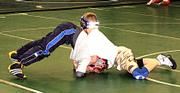 Sunflower wrestler Hunter Haralson, right, has Baldwin wrestler Jack Mitchell in a head lock and pinned to the grounf during a drill Dec. 15 at Free State High School. Haralson took the Mid-America National Champion title in his age bracket last season.
