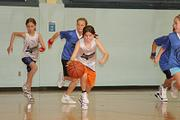 Dribbling Dragon Maren Kahler, center, takes the ball up court on a fast break for two points against the Dunkers on Dec. 10 at Holcom Park Center. The Dunkers ended up winning the game by two points, but during the game both third- and fourt-grade teams showed the improved skill their coaches talked about after the game.