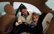 Eudora resident Kelci Younger buckles her 18-month-old daughter, Kailyn, into a car seat after finishing some last-minute Christmas shopping Friday afternoon at SuperTarget, 3201 Iowa. Some child advocates will be pushing for stricter seat belt laws during the upcoming legislative session.