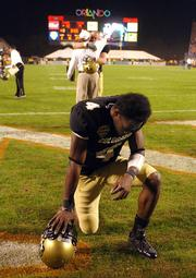 Colorado's Patrick Williams kneels in the end zone after a 19-10 loss to Clemson in the Champs Sports Bowl. The loss Tuesday in Orlando, Fla., was CU's fourth straight setback.