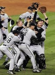 Jubilant White Sox celebrate after beating the Houston Astros, 1-0, to win the World Series in this file photo from Oct. 26. Chicago's first World Series since 1917 was voted Monday as the sports story of the year in balloting by newspaper and broadcast members of the Associated Press.