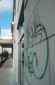Graffiti has been popping up on the just-finished $9 million Hobbs Taylor Lofts in the 700 block of New Hampshire. This marking on the building's west side facing New Hampshire Street was photographed on Christmas.