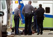 "Lawrence Police officers arrested ""Simon"", Friday afternoon at 7th and New Hampshire after fielding several calls about simon being in the street from 19th and Haskell, concerned that he might be a danger. As police were doing their job, one accident happened and almost another due the combat nature of Simon."