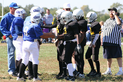 The sixth-grade Hurricanes and Cougars shake hands before the coin toss. The Hurricanes got the ball first Oct. 9 at Youth Sports Inc.