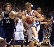Kansas forward Christian Moody rips away an offensive rebound from Yale forward Sam Kaplan during the first half.