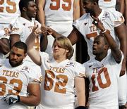 Texas quarterback Vince Young (10) and center Lyle Sendlein gesture during a team photo session at the Rose Bowl. The Longhorns, shown Tuesday in Pasadena, Calif., will play USC in the national-championship game tonight.