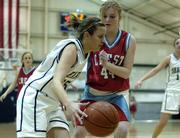 Seabury Academy's Lindsey Ahlen, left, drives past Crest's Dallyn Beecher. The Seahawk girls lost, 41-26, Tuesday at Seabury.
