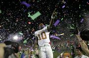 Texas quarterback Vince Young celebrates after Texas beat Southern California, 41-38, in the Rose Bowl. Young scored the game-winning TD in the final seconds Wednesday in Pasadena, Calif.
