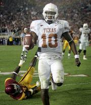 Texas quarterback Vince Young runs for the game-winning touchdown against Southern California. Young's eight-yard run with 19 seconds remaining gave the Longhorns a 41-38 victory in the Rose Bowl on Wednesday night in Pasadena, Calif.
