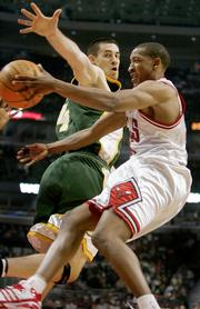 Seattle SuperSonics forward Nick Collison, left, defends a pass from Chicago Bulls guard Chris Duhon. Collison had nine points and nine rebounds Wednesday in Chicago.