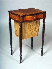 This federal mahogany and satinwood veneer sewing table was probably made in Salem, Mass., about 1805. The table, 29 inches high by 18 inches wide by 14 1/2 inches deep, sold at a Skinner auction in Boston for $43,475.