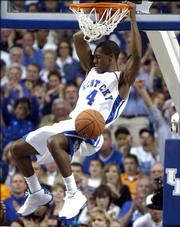 Kentucky's Rajon Rondo slams a dunk in the first half of the University of  Kentucky and Georgetown(Ky.) College basketball game played Wed. Nov. 9, 2005  at Rupp Arena in Lexington, Kentucky.