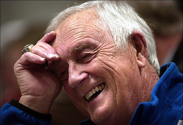 Longtime Kansas University basketball radio broadcaster Max Falkenstein enjoys a laugh in the media room prior to the start of a 2006 home game against Yale at Allen Fieldhouse.