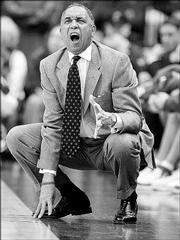 Kentucky coach Tubby Smith yells at his squad during a game against Ohio. Smith, shown Dec. 30, 2005, in Cincinnati, was a UK assistant under Rick Pitino in 1989 when Kansas University beat the Wildcats, 150-95, in Allen Fieldhouse.