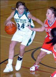 Free State's Jenna Brantley drives against Olathe North Friday at Free State.