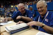Jayhawk Radio Network tandem, Bob Davis, left, and Max Falkenstein, right, share a laugh before the Wednesday night's game against Yale. Davis and Falkenstein have worked together since 1984.