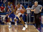 KU's Mario Chalmers drives a fastbreak after a steal against Kentucky's Ramel Bradley in the first half.