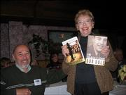 Sue Leonard, a volunteer at the Dole Institute of Politics, won signed copies of two books written by Bob Dole during the door prize drawings at the Dole Institute's volunteer and student recognition luncheon at Paisano's Ristorante. More than 30 volunteers, students and guests attended the Dec. 10 event. At left is Alan Miller, of Lawrence, husband of Sandi Miller, a Dole archive volunteer.