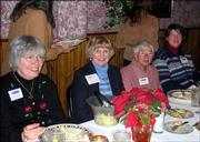 From left are Dianna Nelson, Jane Pracht, Thelma Helyar and Stacy Houston, all of Lawrence and archival volunteers at the Dole Institute of Politics. They attended a recognition luncheon Dec. 10 at Paisano's Ristorante in Lawrence.