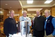 From left, Steve Sublett, Max Rife, Darrell Falen and Stan Roth attend the annual luncheon for retired faculty and staff of Lawrence High School. The event was Dec. 7 in the school's library.