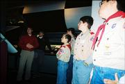 Baldwin Boy Scout Troop 65 members, from left, James Simmons, Andrew Morgan, Brandon Baltzell and Thomas Bollig listen to a tour leader talk about the World War II era V2 rocket at the Kansas Cosmosphere in Hutchinson. The scouts visited the center Dec. 10.