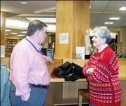 Terry Wells, left, visits with Janet Mody during the annual luncheon for retired faculty and staff of Lawrence High School. The luncheon was Dec. 7 in the LHS library.