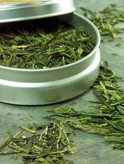 This tin holds dried green tea leaves. With its high antioxidant count, green tea is said to slow certain types of cancer, reduce the danger of hypertension and help fight Alzheimer's