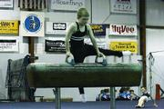 Charlie Arnold performs his pommel horse routine for the judge Saturday at the Winter Cup meet held at Lawrence Gymnastics Academy. Arnold used the home crowd to energize him to place second int he pommel horse, floor exercise, rings, parallel bars and All-Around.