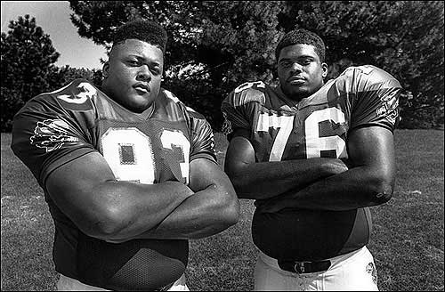 Gilbert Brown, left, and Khristopher Booth helped lead the 1992 Jayhawk defense.