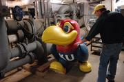 Classic Jayhawk, by Katie Kring, sits in the basement of the Kansas Union damaged beyond repair. Wayne Pearse, right, an engineer with KU Memorial Unions, tried to repair the sculpture after it was damaged by vandals but the damage was determined to be too severe to fix.