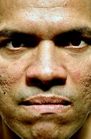 "The face of Santiago Vasquez, as portrayed in the movie poster for ""First Date."""