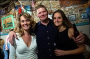 From left are Julie Ransopher, Kansas City, Mo.; Charlie Crumpton, Tulsa, Okla.; and Sherri Willdeman, Lawrence. They celebrated on New Year's Eve at The Sandbar, 17 E. Eighth St.