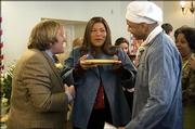 """Gerard Depardieu, left, Queen Latifah and LL Cool J star in the romantic comedy """"Last Holiday,"""" a remake of the 1950 film of the same name."""