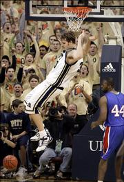 Pittsburgh fans cheer as Pittsburgh's Aaron Gray, left finishes a dunk behind DePaul's Marlon Brumfield in the second half of Pittsburgh's 73-65 win of the college basketball game in Pittsburgh on Thursday, Jan. 12, 2006. (AP Photo/Keith Srakocic)