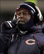 Chicago Bears coach Lovie Smith looks on from the sidelines against the Atlanta Falcons during NFL football action  in this Dec. 19, 2005 photo, in Chicago. In a breakthrough year for black coaches, the Chicago Bears' Lovie Smith and Cincinnati Bengals' Marvin Lewis led once-moribund teams to division championships. Tony Dungy's Indianapolis Colts flirted with a perfect season. Now their success _ Smith and Dungy finished 1-2 in AP Coach of the Year voting _ might be making less-successful teams more receptive to other minority coaching candidates. (AP Photo/Nam Y. Huh)