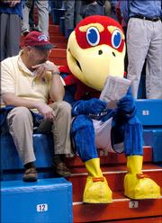 Ed Lanning, Overland Park, lets Big Jay read his newspaper before tipoff of last Saturday's men's basketball game against Kentucky in Allen Fieldhouse. KU defeated the ranked Wildcats 73-46. Today, KU plays rival Kansas State University at home.