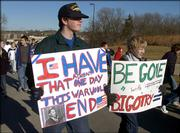 Josh Drentlaw, left, and Andrew Woodhead carried signs Friday expressing their thoughts about King.