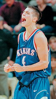 Former Kansas University guard Ryan Robertson lets out a yell after the Jayhawks defeated Missouri, 73-61, in this file photo from 1999 in Robertson's final trip to Columbia, Mo., as a Jayhawk.