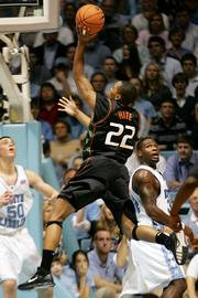 Miami's Robert Hite (22) shoots over North Carolina's David Noel. The Hurricanes beat the Tar Heels, 81-70, Saturday in Chapel Hill, N.C.