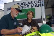 Bud Waugh and Paula Phillips, members of the Community Emergency Response Team in Douglas County, check out some of the team's emergency gear that could be used in the event of a natural disaster or other emergency.